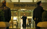 Police and fire department officers stand outside Trump Tower where detectives and other agencies were investigating a suspicious white powder found inside the building, Thursday, April 28, 2016, in New York. Six people were being evaluated by emergency medical crews after an envelope containing a white powdery substance was mailed to Republican presidential candidate Donald Trump's campaign office in New York City. Police said a Trump staffer opened the letter containing the powder and immediately called police. It was unclear if the envelope also contained a letter. (AP Photo/Kathy Willens)