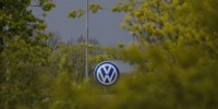 VW sees second quarter profit halved after emissions scandal