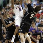 LSU's Marcus Thornton (5) shoots over Butler's Matt Howard (54) and Ronald Nored (5) during the second half of LSU's 75-71 win in a first-round men's NCAA college basketball tournament game in Greensboro, N.C., Thursday, March 19, 2009. (AP Photo/Steve Helber)