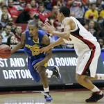 Morehead State's Brandon Shingles, left, drives past Louisville's Jared Swopshire in the first half of a first-round NCAA men's college basketball tournament game Friday, March 20, 2009, in Dayton, Ohio. (AP Photo/Skip Peterson)