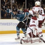 San Jose Sharks' Jody Shelley (45) celebrates his goal against Phoenix Coyotes goalie Ilya Bryzgalov (30), of Russia, during the second period of an NHL hockey game Saturday, March 28, 2009, in San Jose, Calif. (AP Photo/Ben Margot)