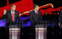 Donald Trump, left, and Jeb Bush, right, both speak as Ted Cruz looks on during the CNN Republican presidential debate at the Venetian Hotel & Casino on Tuesday, Dec. 15, 2015, in Las Vegas. (AP Photo/John Locher)