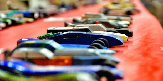 A line of Pinewood Derby cars are lined up, ready to race. (Facebook/Lincoln Pinewood Derby)