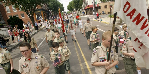 Boy Scouts walk along Mills Street in Danville, Pa., while taking part in the annual Memorial Day p...