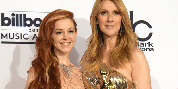 Lindsey Stirling, left, and icon award winner Celine Dion pose in the press room at the Billboard M...