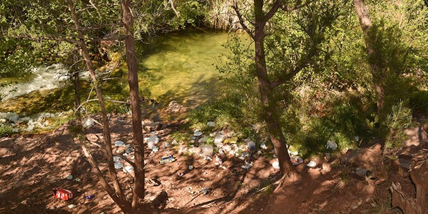 Trash left behind by visitors at Fossil Creek Springs before the permit system was implemented. (Cronkite News Photo/Isabel Menzel)