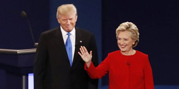 Democratic presidential nominee Hillary Clinton, right, stands with Republican presidential nominee Donald Trump at the start of the presidential debate at Hofstra University in Hempstead, N.Y., Monday, Sept. 26, 2016. (AP Photo/Mary Altaffer)