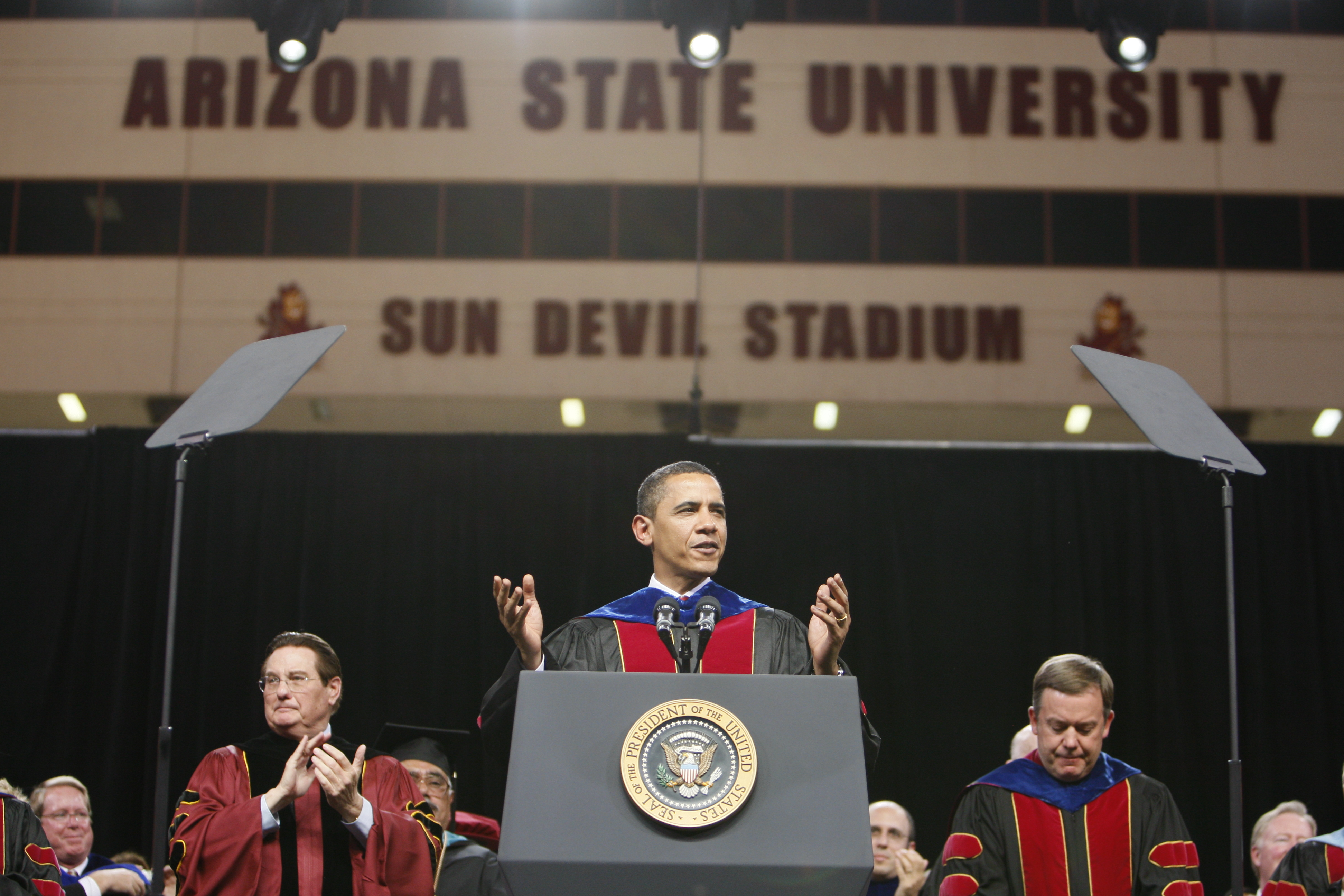 President Barack Obama speaks at the Arizona State University commencement ceremony at Sun Devil Stadium in Tempe, Ariz., Wednesday, May 13, 2009. (AP Photo/Charles Dharapak)