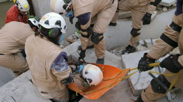 """This image released by Netflix shows a scene from the documentary """"White Helmets."""" The 40-minute Netflix documentary, is nominated for an Oscar for Best Documentary Short. A 21-year-old Syrian cinematographer Khaled Khateeb, one of three people credited for cinematography, has been blocked from traveling to Los Angeles for the Oscars.  (Netflix via AP)"""