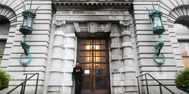 A man stands outside the main door outside the 9th U.S. Circuit Court of Appeals building Thursday, Feb. 9, 2017, in San Francisco. (AP Photo/Marcio Jose Sanchez)