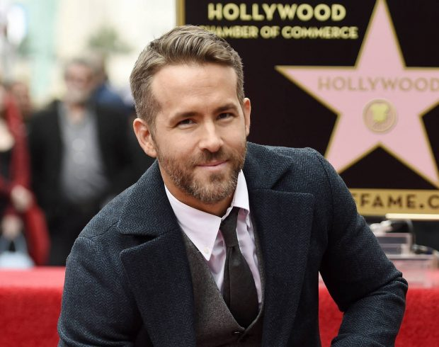 "FILE - In this Dec. 15, 2016, file photo, actor Ryan Reynolds poses at a ceremony honoring him with a star on the Hollywood Walk of Fame in Los Angeles. There's a bromance brewing between actors Jake Gyllenhaal and Reynolds. The Hollywood stars say they hit it off so well during the filming of their new sci-fi thriller called ""Life"" that a genuine friendship has blossomed. (Photo by Chris Pizzello/Invision/AP, File)"
