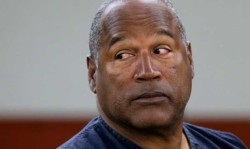 FILE - In this May 15, 2013, file photo, O.J. Simpson returns to the witness stand to testify after a break during an evidentiary hearing in Clark County District Court in Las Vegas. (AP Photo/Julie Jacobson, Pool, File)