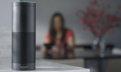 This product image provided by Amazon shows the Amazon Echo speaker.  (Amazon via AP)