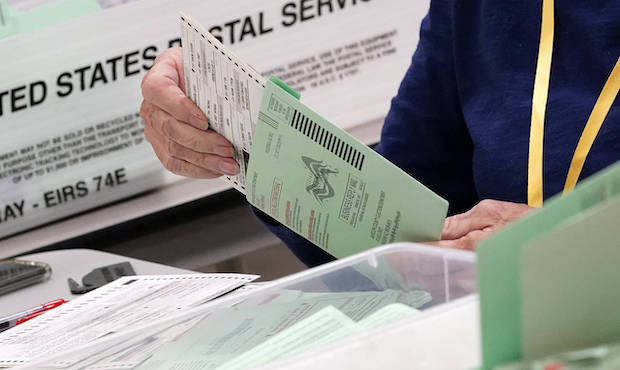 Election workers sort ballots Wednesday, Oct. 21, 2020, at the Maricopa County Recorder's Office in...
