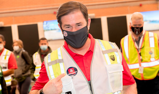 Gov. Doug Ducey poses after receiving his second dose of COVID-19 vaccine in Tucson on March 24, 20...