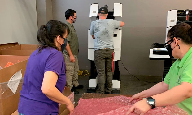 Maricopa County elections staffers take inventory before retrieving machines auditors finished insp...