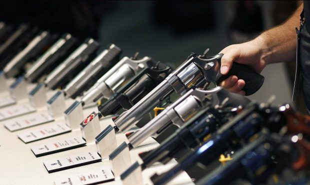FILE - In this Jan. 19, 2016, file photo, handguns are displayed at the Smith & Wesson booth at the...