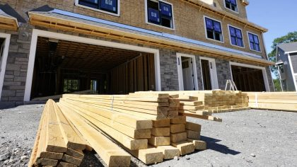 In this June 24, 2021 photo, lumber is piled at a housing construction site in Middleton, Mass.  Ri...