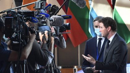 France's European Affairs Minister Clement Beune, right, speaks with the media as he arrives for a ...