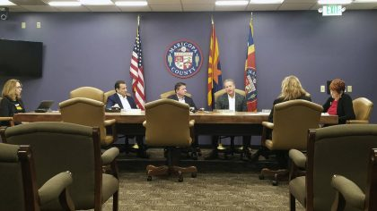 FILE - In this Dec. 27, 2019, file photo, the Maricopa County Board of Supervisors meets in Phoenix...