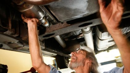 A mechanic works on replacing a catalytic converter in Davie, Florida, in this 2009 file photo. (Ph...