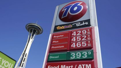 FILE - Gas prices are shown at a station, Thursday, Sept. 2, 2021, near the Space Needle in Seattle...
