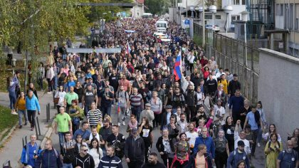 Demonstrators march during a protest against vaccinations and coronavirus measures in Ljubljana, Sl...