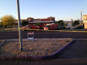 Driver runs red light in south Phoenix, tips over ambulance